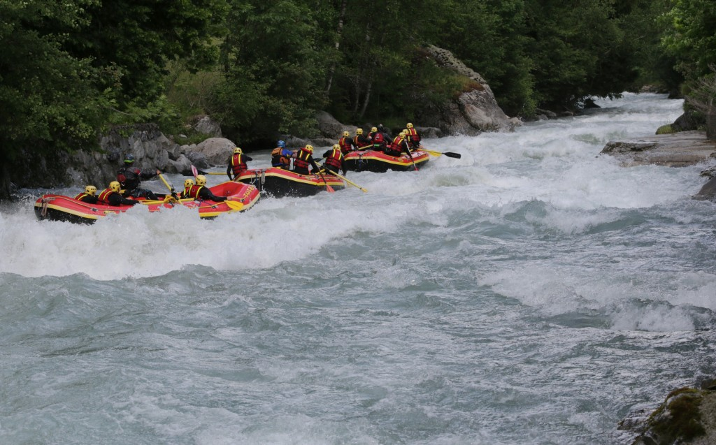 Years of river experience leads to this. A Rafting Train passing through Champex. Photo - Aurelien Sudan